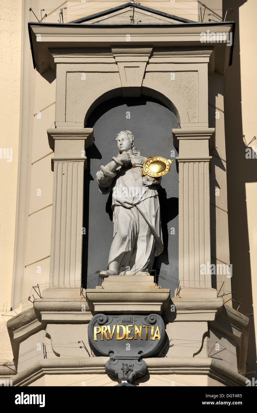 Statue of Prudentia, the goddess of wisdom, on the baroque facade of the city hall, 1704, Am Markt square 1, Lueneburg - Stock Image