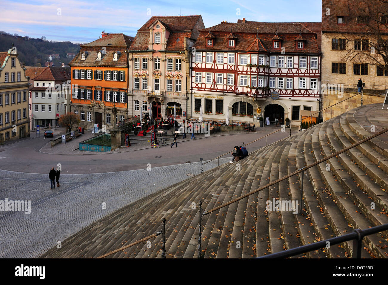 View from the flight of stairs in front of Saint Michael towards the old building facades on Marktplatz square, Schwaebisch Hall - Stock Image