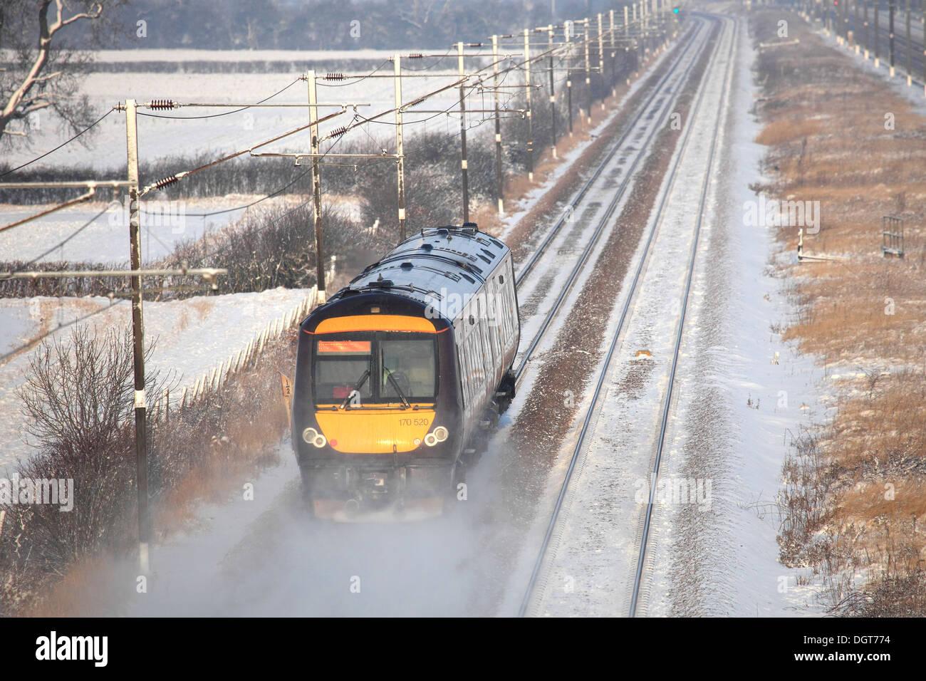 Winter Snow, 170520 County 2 County trains Turbostar Train, High Speed Diesel Train, East Coast Main Line Railway Cambridgeshire - Stock Image