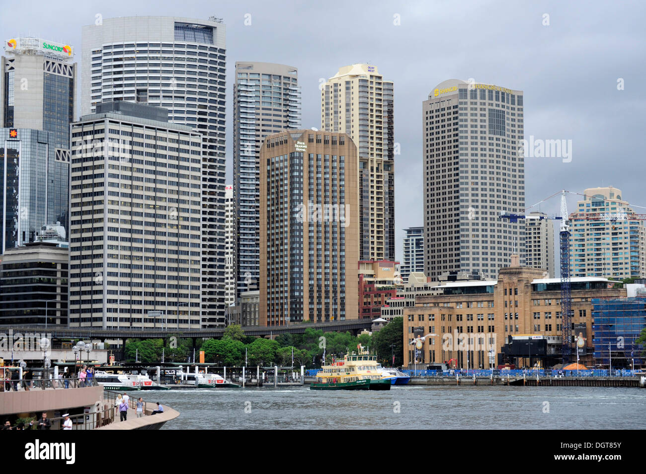 Circular Quay Ferry Wharf, Sydney Cove, Sydney Harbour, city centre at the rear with high-rise office buildings in the Central - Stock Image