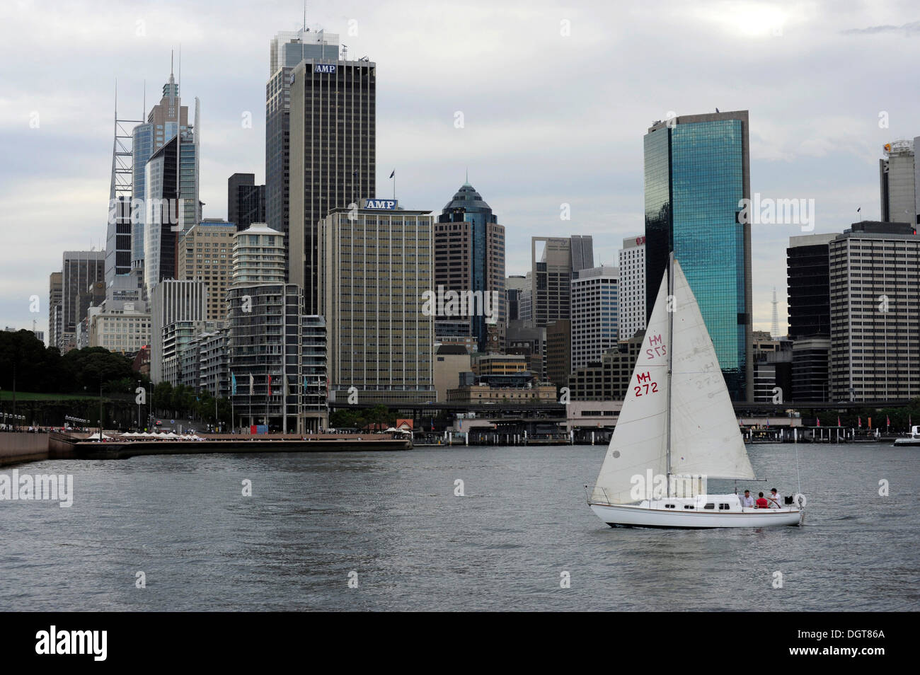 Sailing boat in Sydney Cove, Sydney Harbour, at back the city centre, Central Business District, CBD, Sydney City, Sydney - Stock Image