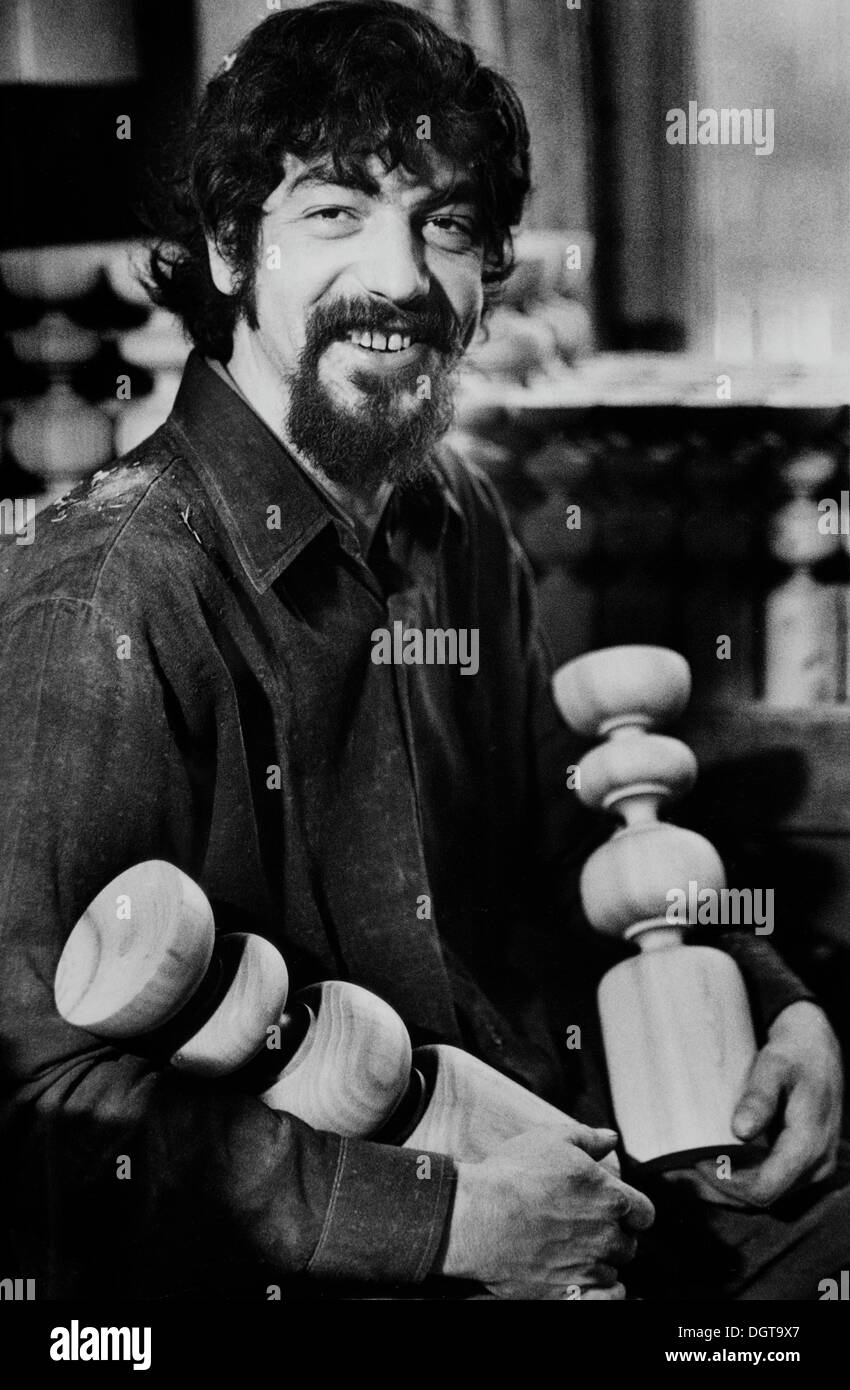 Sculptor holding lathed candle holders, DDR, East Germany about 1976 - Stock Image