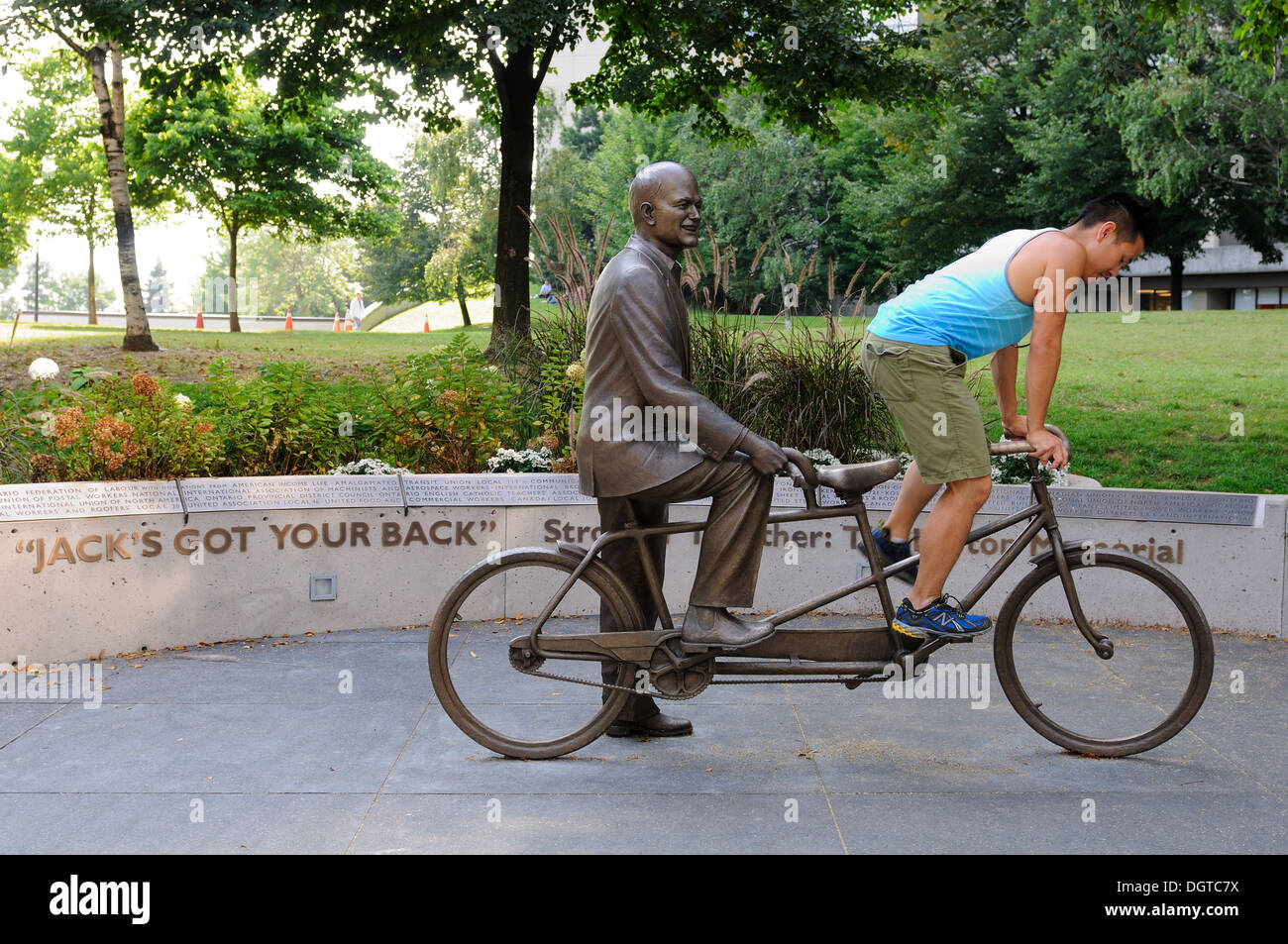 A statue memorializing Jack Layton, a bronze sculpture depicting the former Toronto, NDP leader riding a tandem bike. - Stock Image