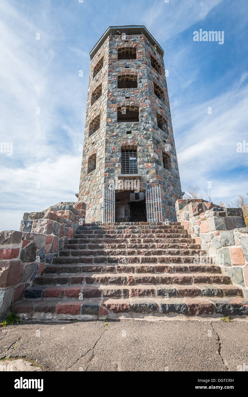 Front entrance of a stone tower during autumn time - Stock Image