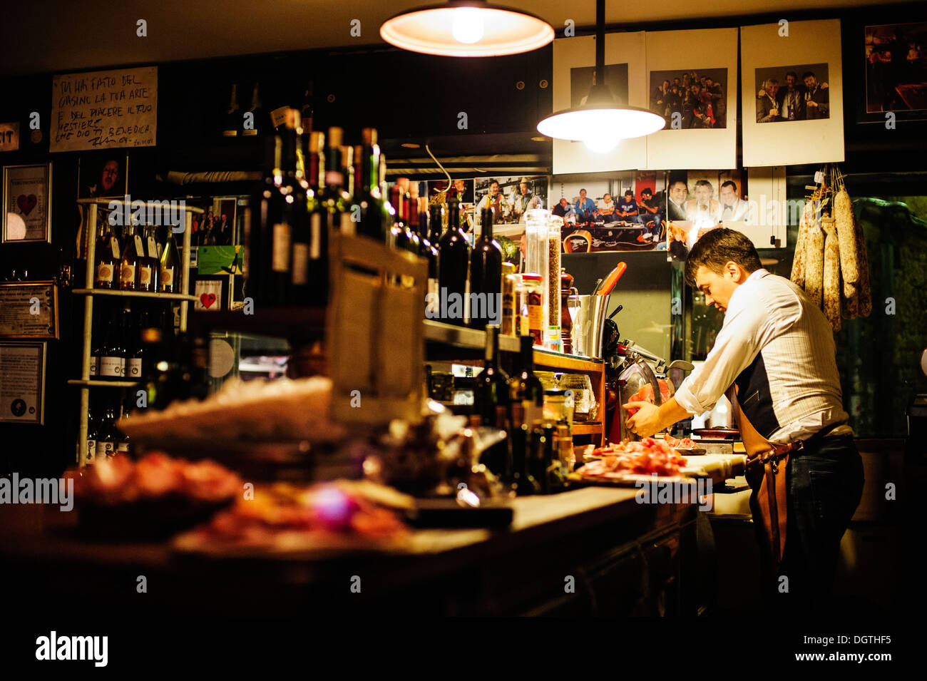 A server carrying a plater of dried meats at La Mascareta restaurant, Venice, Italy. - Stock Image