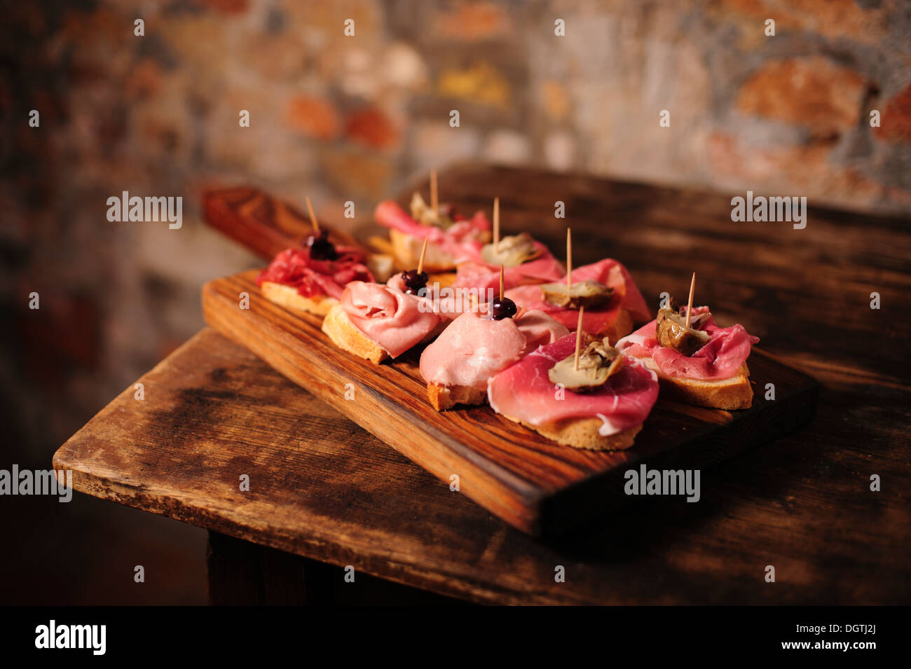 Cured meats Cicchetti appetizers at La Mascareta Restaurant, Venice, Italy. Stock Photo