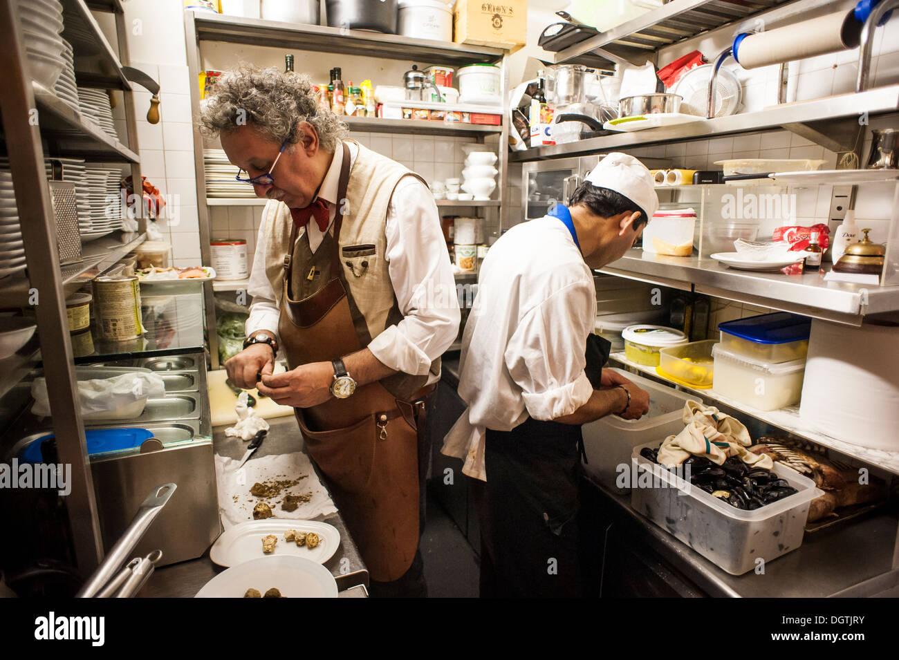 People Working In A Small Professional Kitchen, La Mascareta Restaurant,  Venice, Italy.
