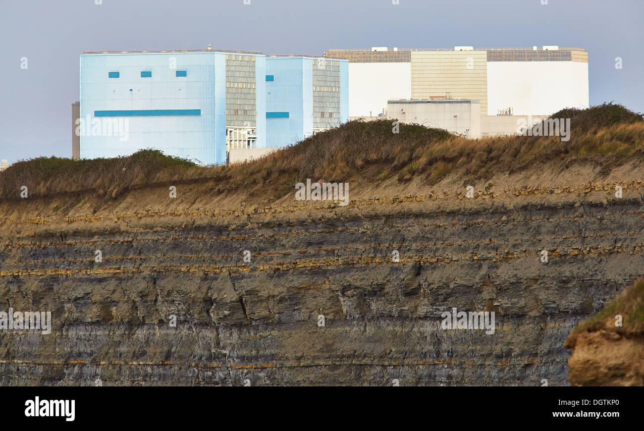 Hinkley Point A and B nuclear power station reactor buildings above Jurassic  cliffs on the Somerset shore of Bristol Channel UK - Stock Image