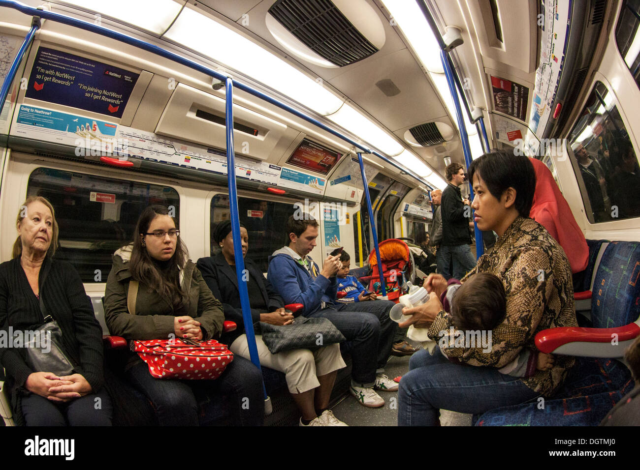 London Underground Train interior with passengers - Stock Image