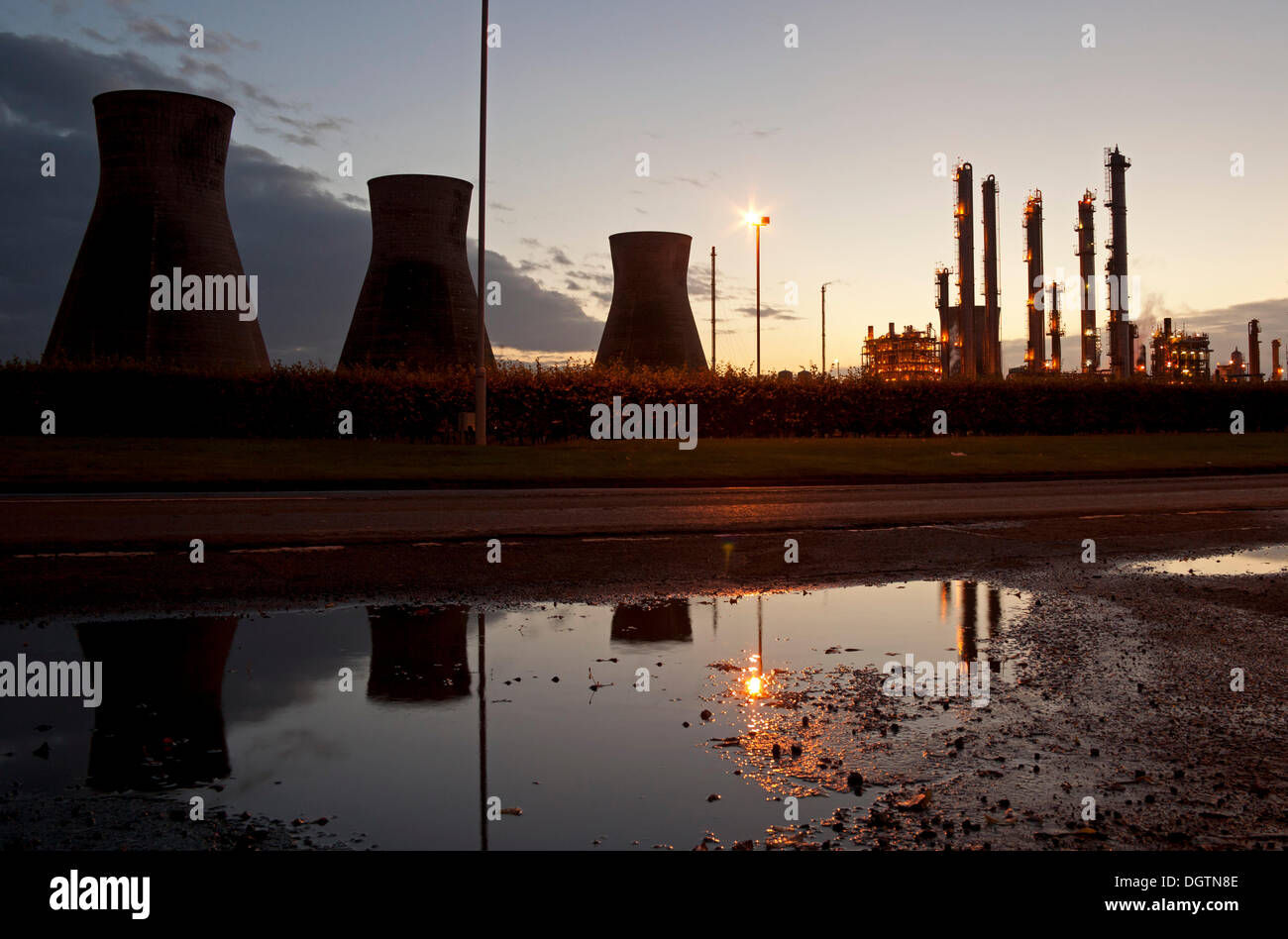 Grangemouth, Scotland UK. 25th Oct. 2013. The Ineos petrochemical plant and the evening sky are reflected as the Stock Photo