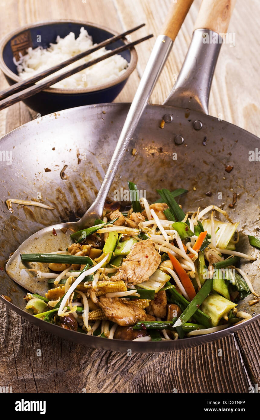 stir fried chicken with vegetables - Stock Image