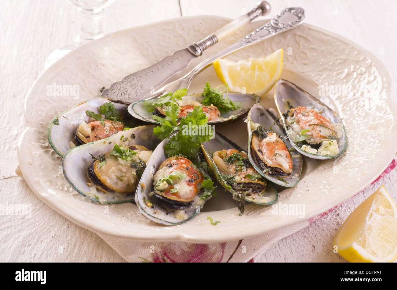 mussels bakes with permasan - Stock Image