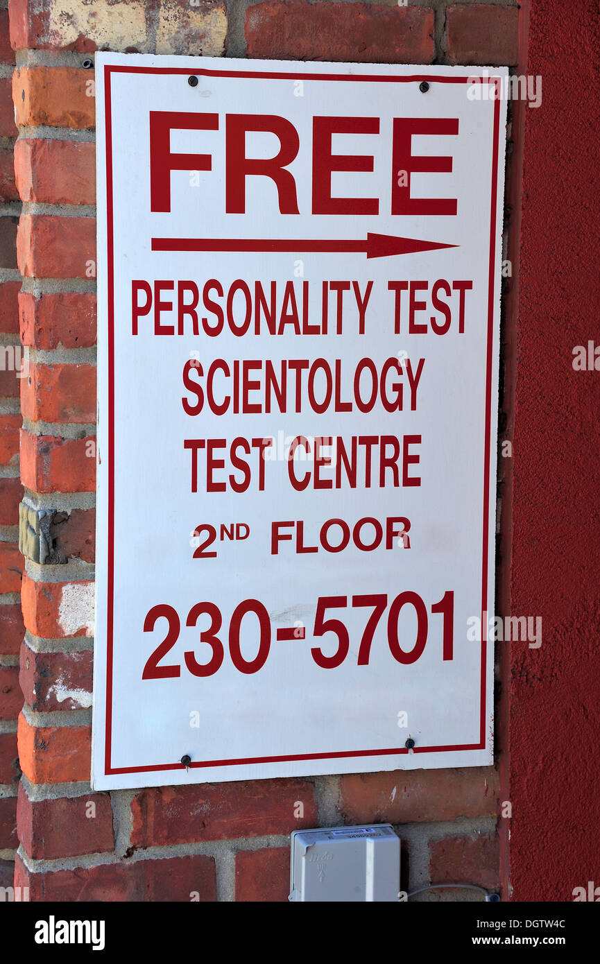 A sign at the entrance to an office block, offering a free Scientology 'personality test' - Stock Image