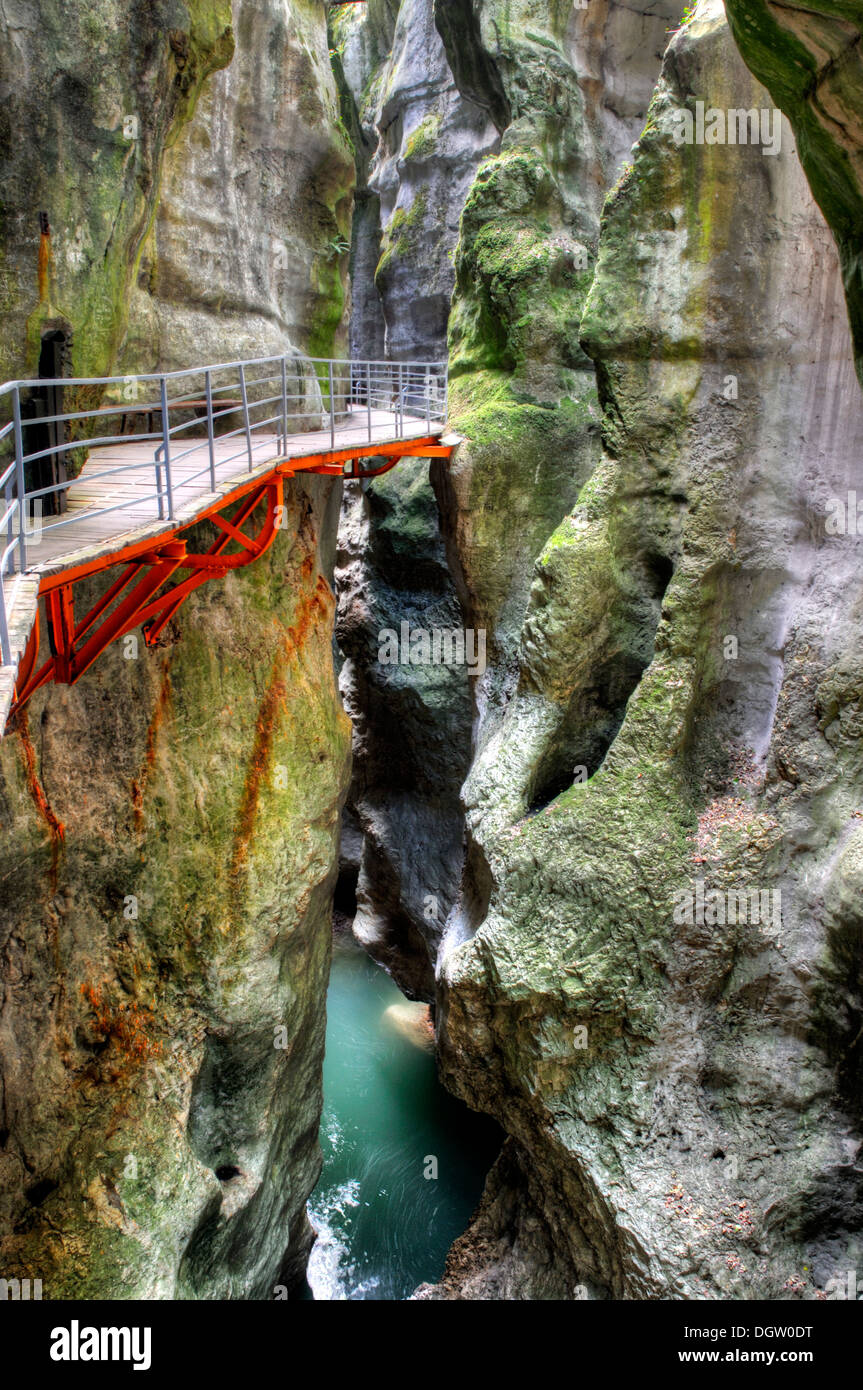 The superb narrow slot canyon Gorges du Fier at Lovagny in France, image processed in HDR - Stock Image