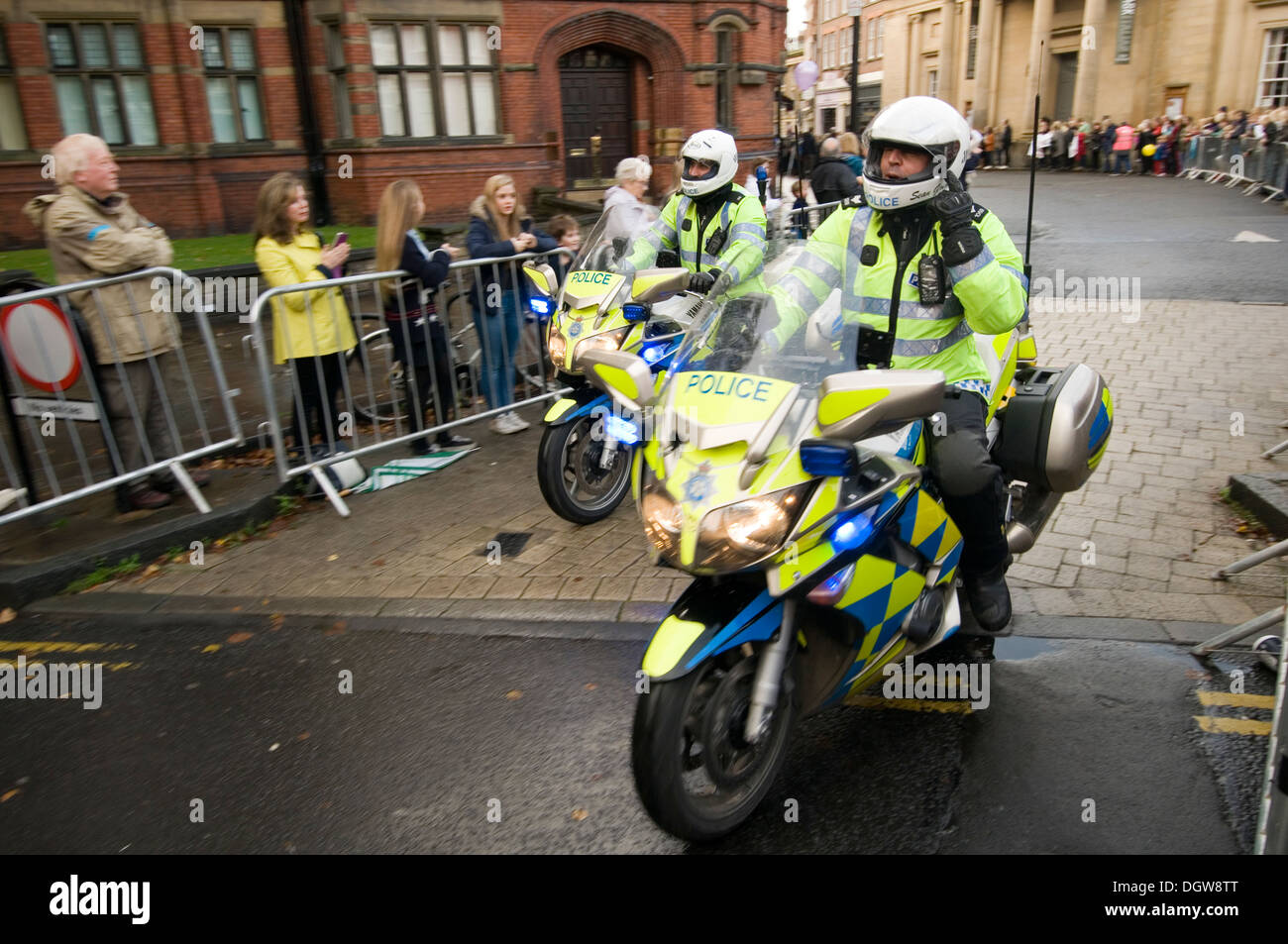 police motorbike motorcycle motor bike cycles man policeman riding rider riders cycle bikes Yamaha out riders outriders escort e - Stock Image