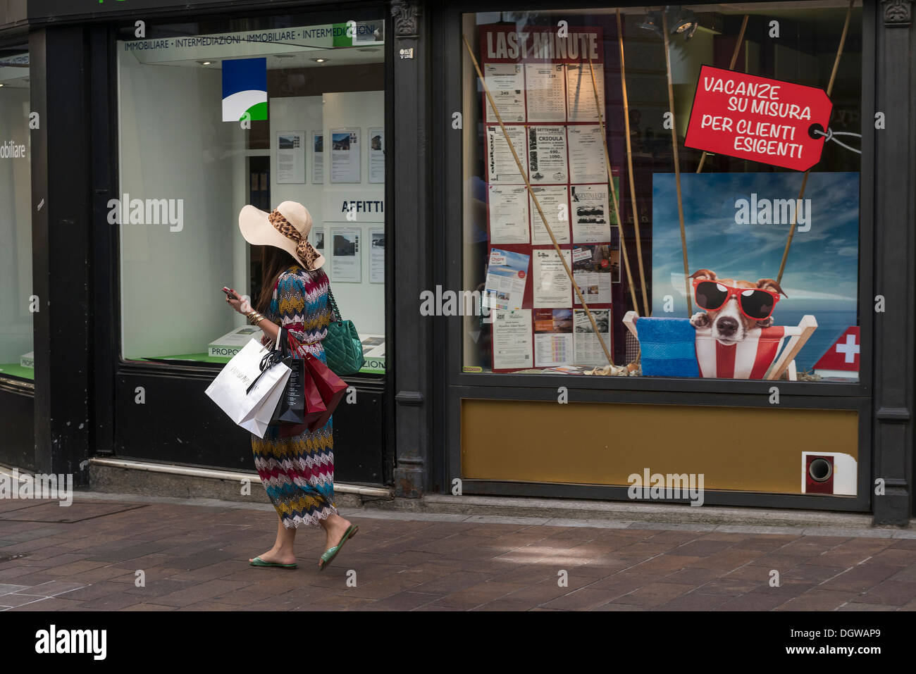 Young adult female designer label shopper. LUGANO. Switzerland - Stock Image
