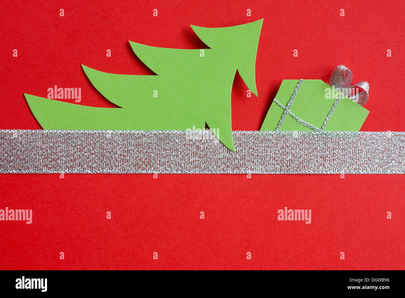 Christmas abstract paper tree on red background - Stock Image