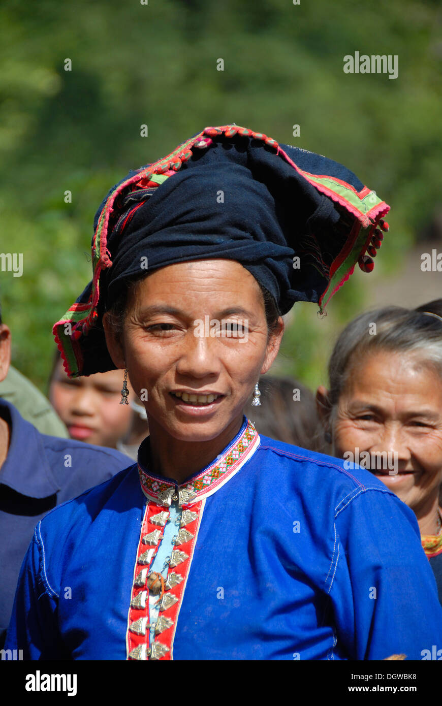 Portrait of a woman of the Tai Dam ethnic group wearing traditional clothing, blue blouse and indigo-coloured headdress - Stock Image
