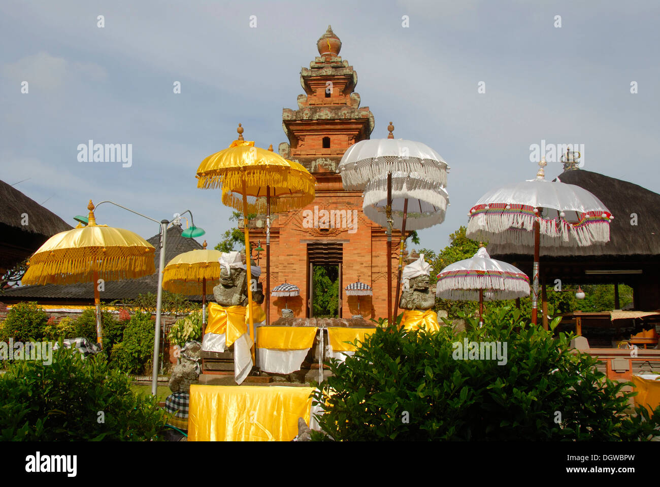 Bali Hinduism, Temple Tower, yellow and white umbrellas, Pura Sadha Temple, Kapal, Bali, Indonesia, Southeast Asia, Asia - Stock Image