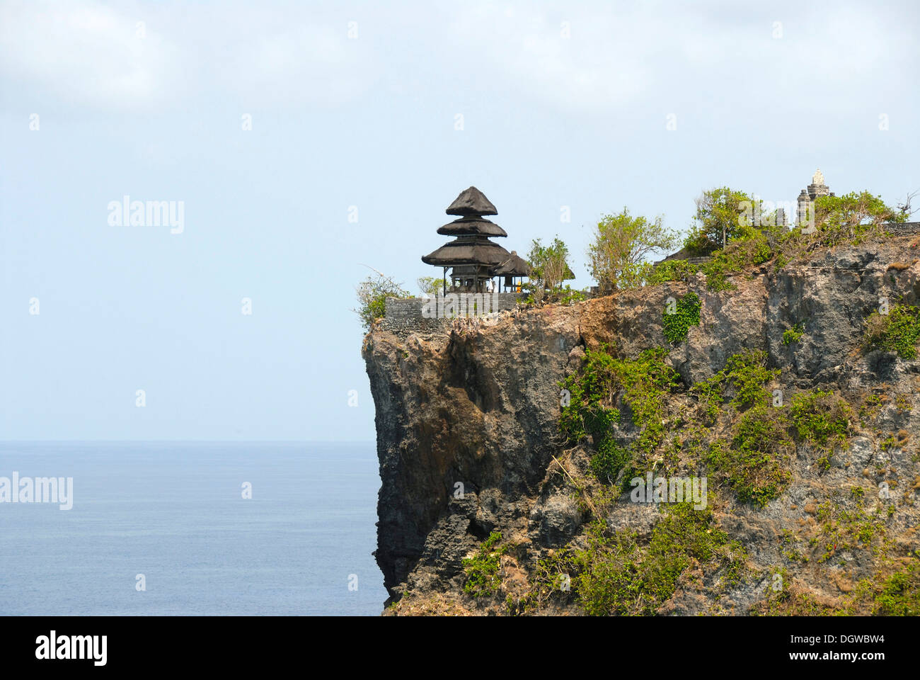Balinese Hinduism, sanctuary on a cliff high above the sea, Balinese pagoda, Pura Luhur Uluwatu temple, Bukit peninsula, Stock Photo