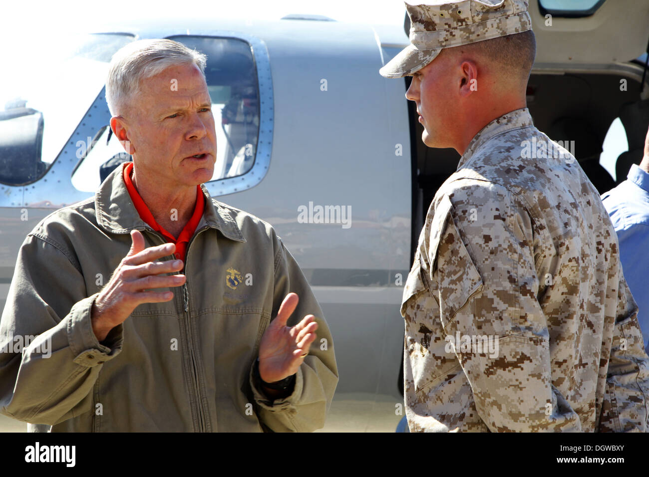 The commandant of the Marine Corps, Gen. James F. Amos, greets U. S. Marine Corps Sgt. Christopher A. Prior, right, Stock Photo
