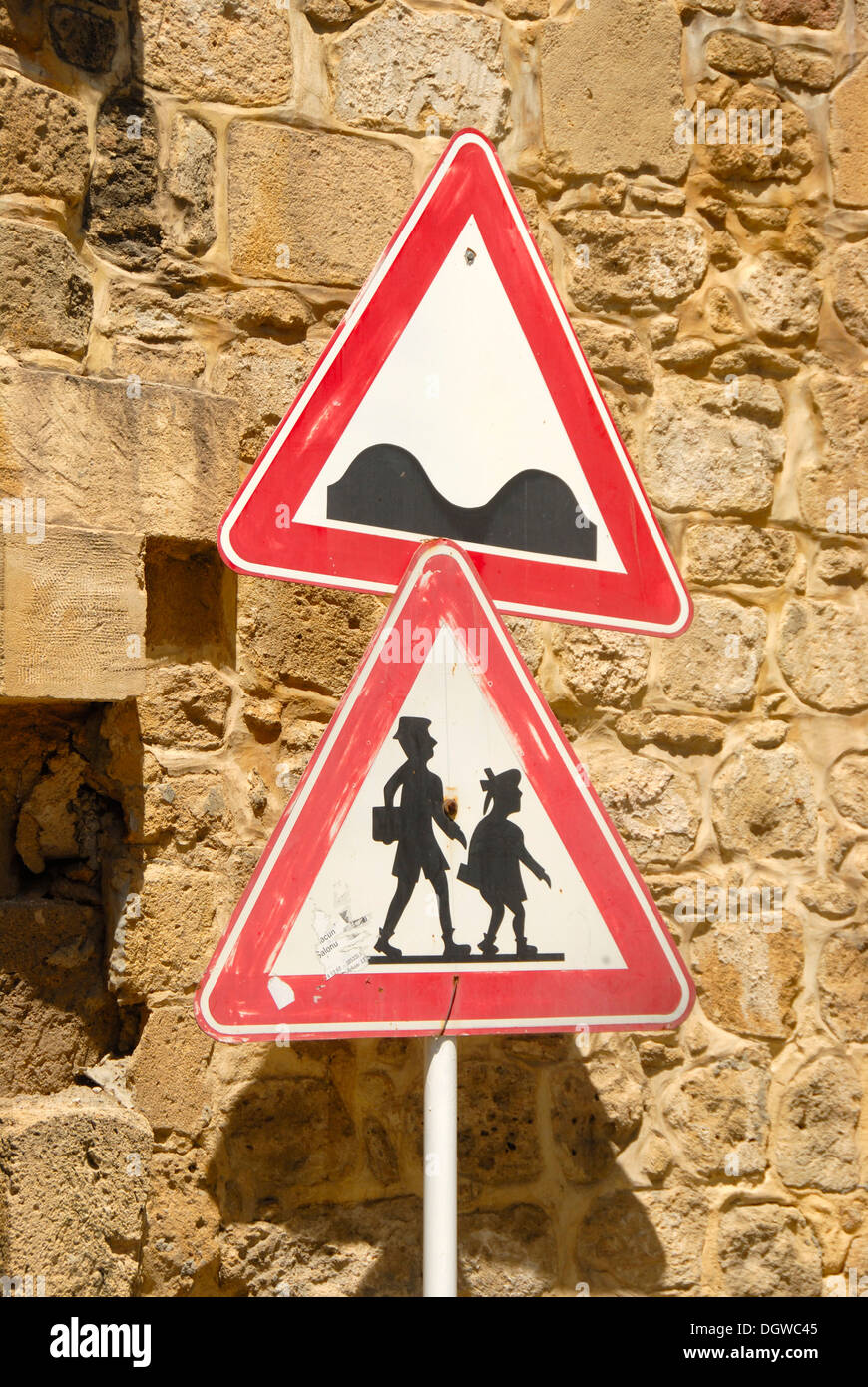 Two traffic signs, caution uneven road, caution pedestrians, Nicosia, Lefkosa, Turkish Republic of Northern Cyprus, - Stock Image
