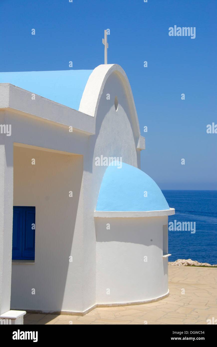 Greek Orthodox Christianity, Church of Ayioi Anargyri, Agioi Anargyroi, chapel, blue sea, Cape Greco, near Ayia Napa - Stock Image
