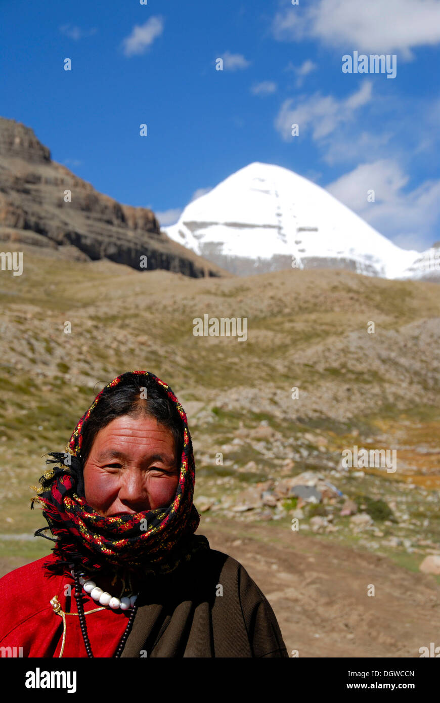 Tibetan Buddhism, Tibetan woman, believer, portrait, snow-covered sacred Mount Kailash, south side, Selung Gompa - Stock Image