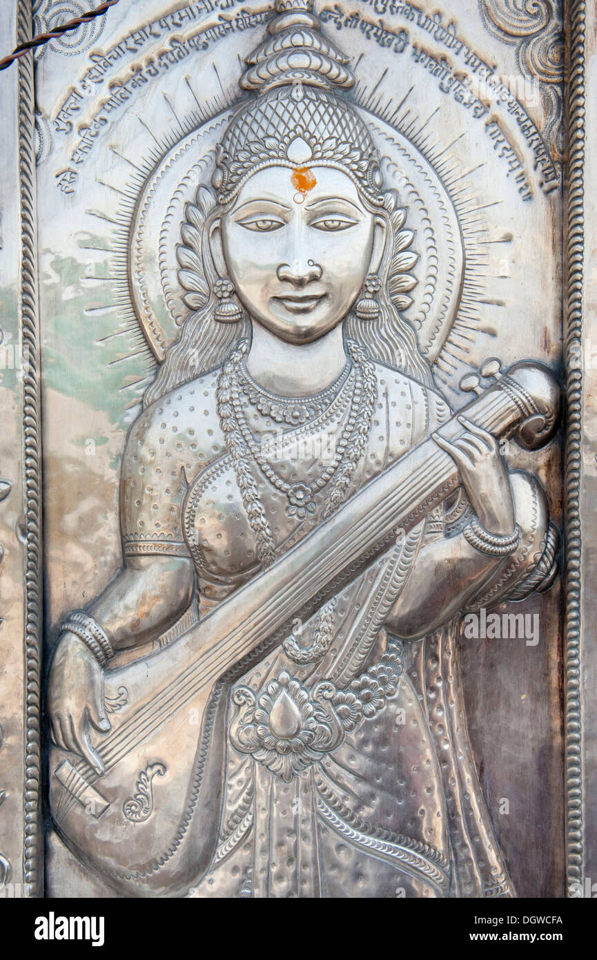 Hinduism, studded silver, Goddess Saraswati holding a musical instrument, goddess of wisdom and learning - Stock Image