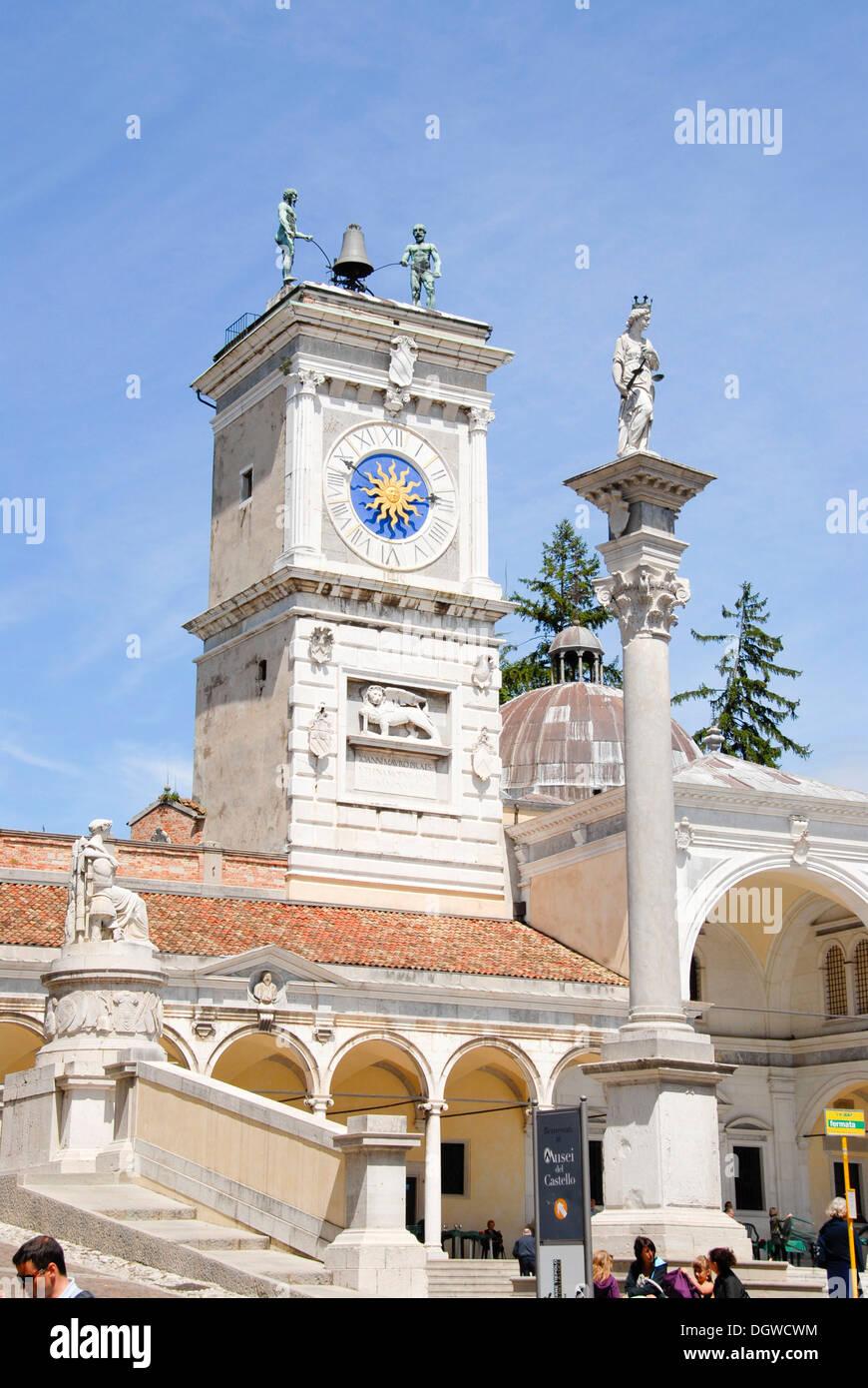 Piazza Libertà square with clock tower and columns of the Loggia di San Giovanni, old town, Udine, Friuli-Venezia Giulia, Italy - Stock Image