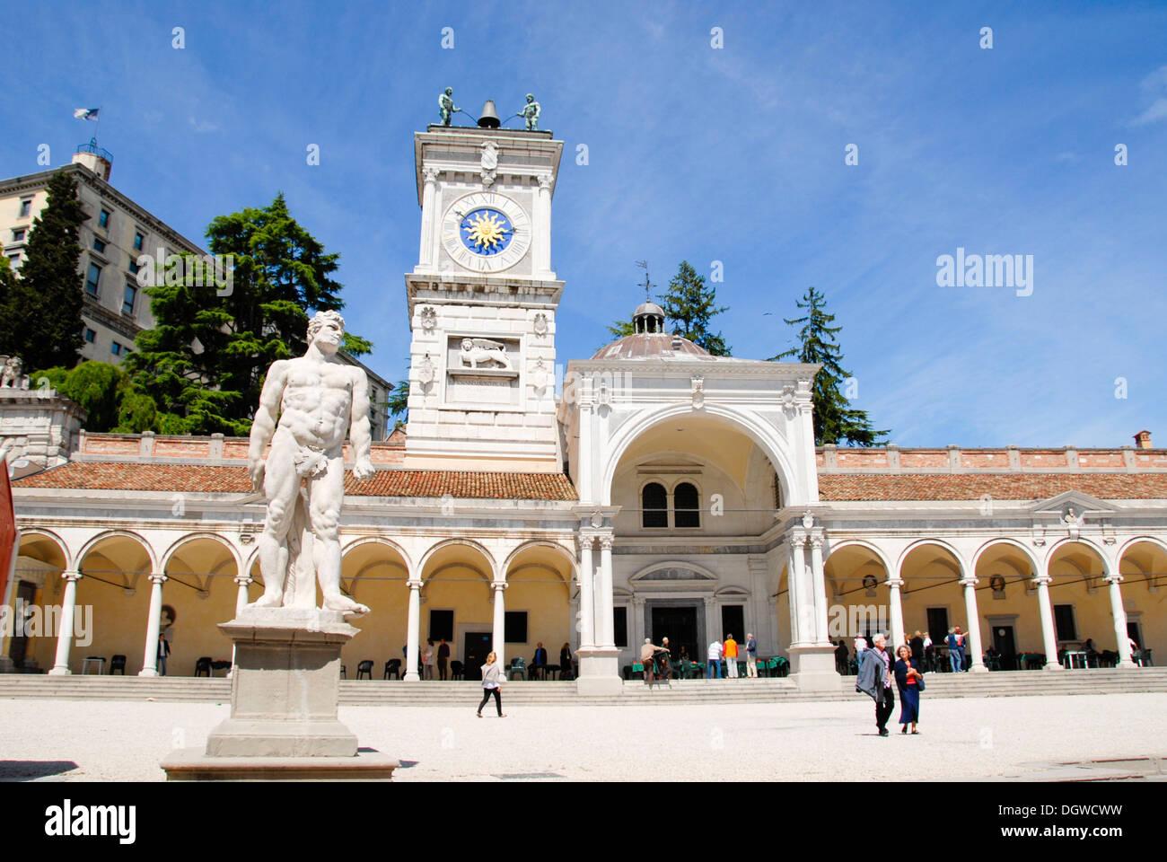 Piazza Libertà square with clock tower and statue, Loggia di San Giovanni, old town, Udine, Friuli-Venezia Giulia, Italy - Stock Image