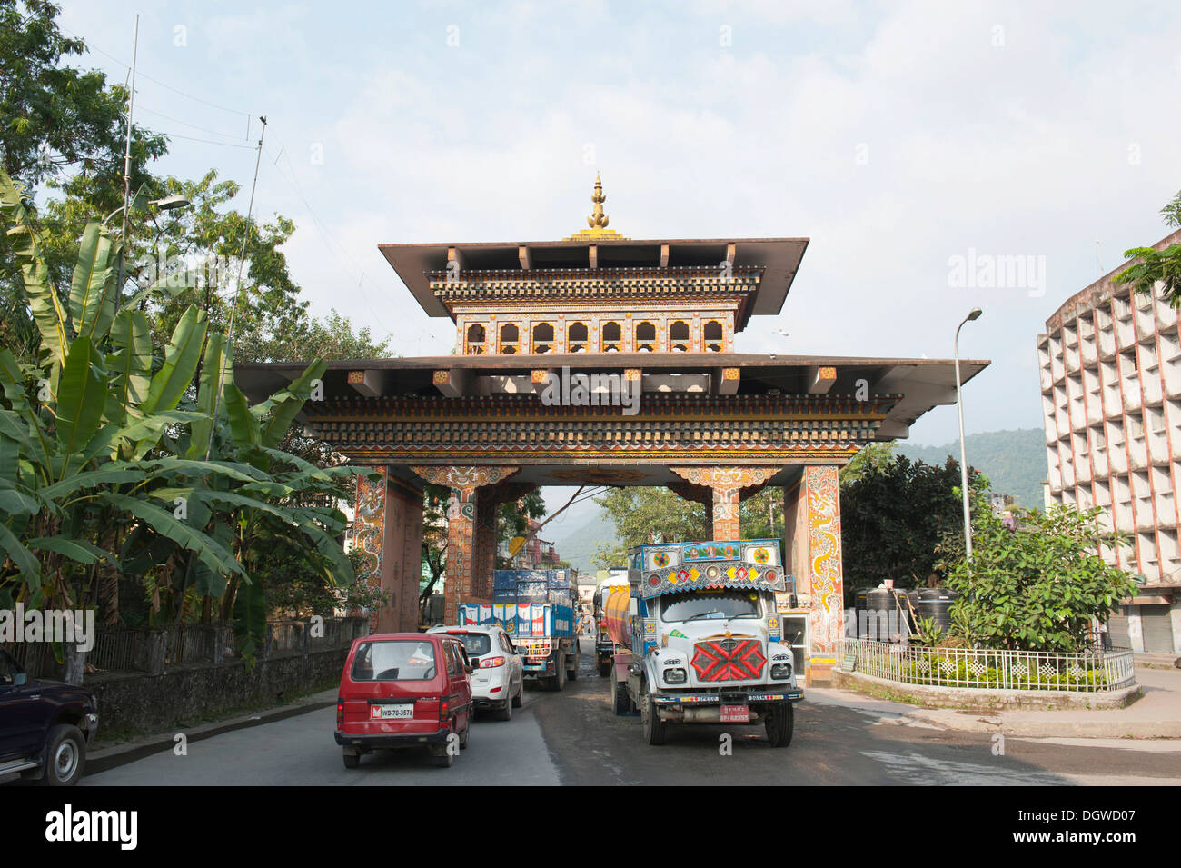 Traffic through Bhutan Gate, border, view from the Bhutan side, Jaigaon in India, Phuentsholing, Kingdom of Bhutan, South Asia - Stock Image