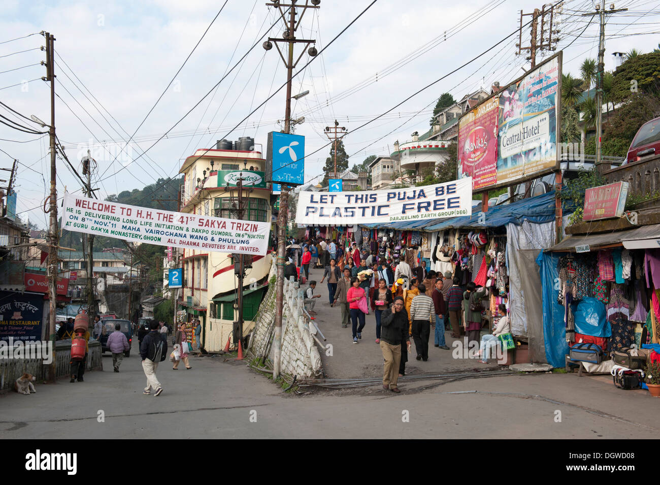 Pedestrians in the town centre, Nehru Road, The Mall, banner calling for avoidance of plastic, Darjeeling, West Bengal, India - Stock Image