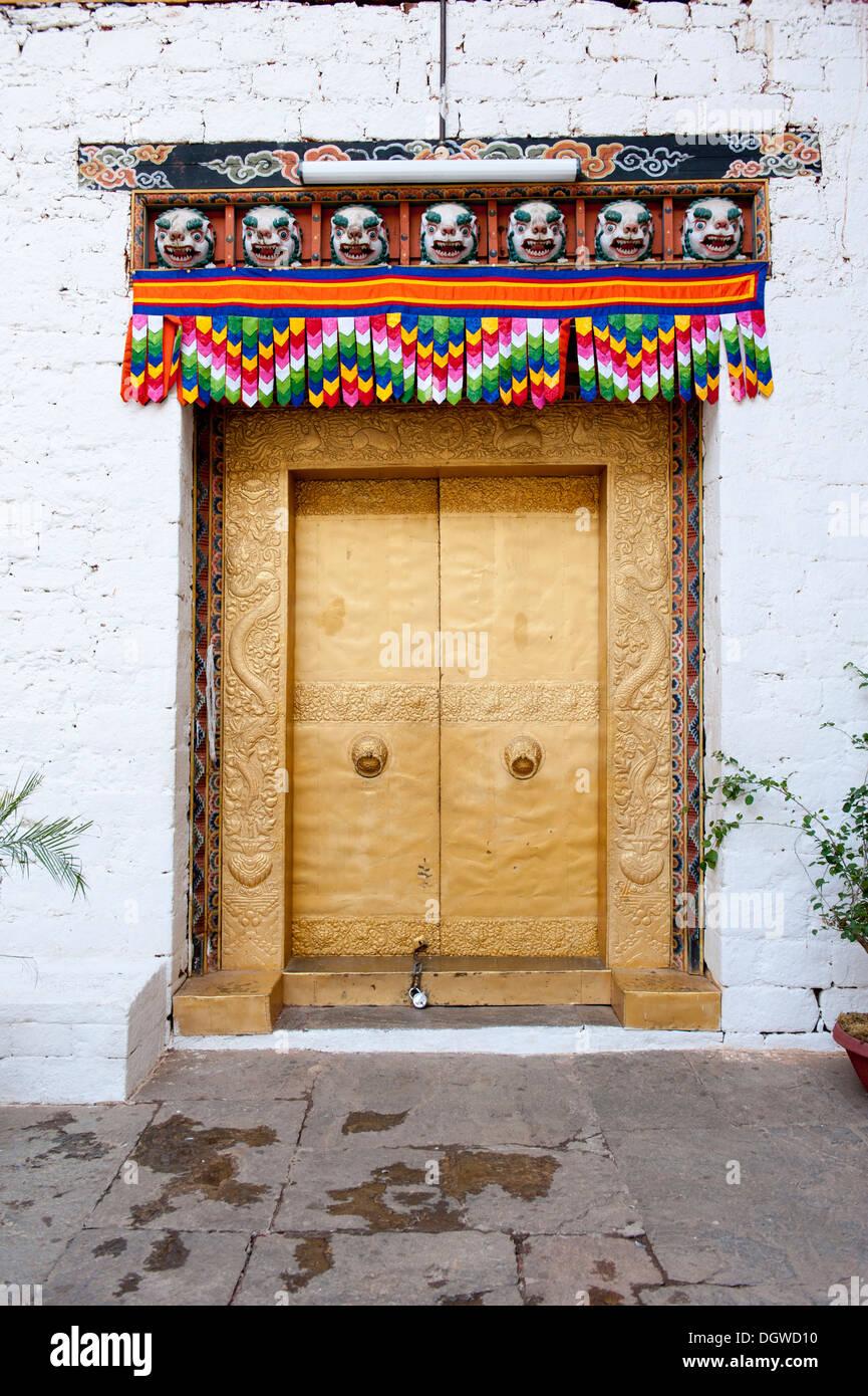 Tibetan Buddhism, gold-studded door, gate, entrance, fortress-monastery, Dzong, Punakha, the Himalayas, Kingdom of Bhutan - Stock Image