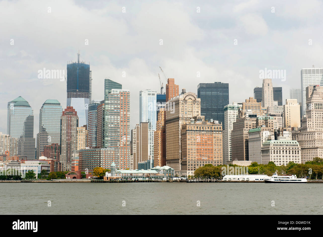 Metropolis, view of high-rise buildings and skyline, Financial District, Battery Park, One World Trade Center under Stock Photo