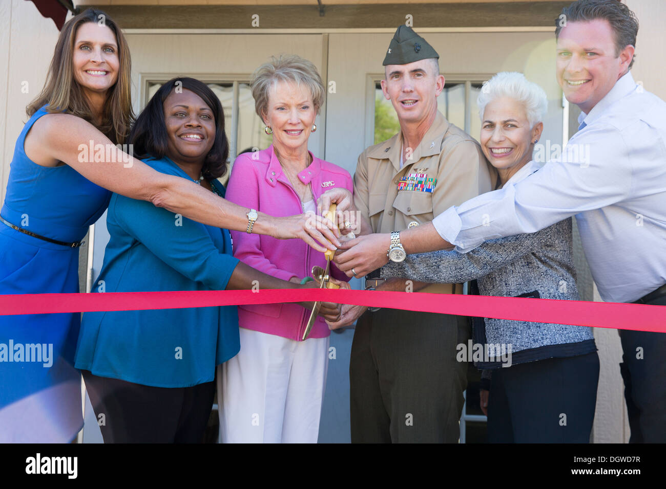 The Marine and Family Program Behavioral Health branch unveils its Community Counseling Center aboard Marine Corps Air Station Miramar, Calif. Oct. 18. From left to right, Deanna Angel, Behavioral Health Branch director, Mary Bradford, Community Counselin - Stock Image