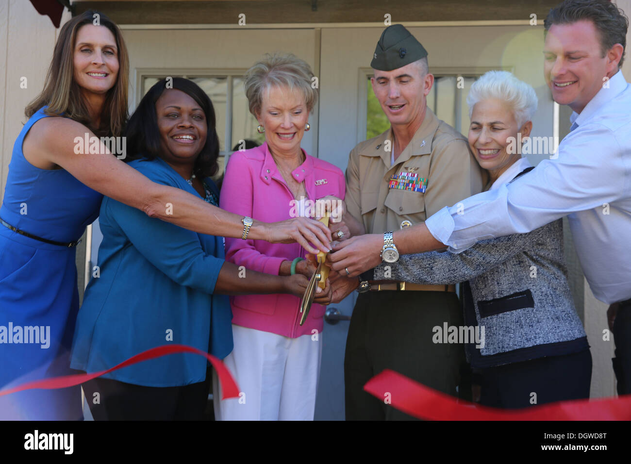 The Marine and Family Program Behavioral Health branch reveals the new Community Counseling Center aboard Marine Corps Air Station Miramar, Calif. Oct. 18. From left to right, Deanna Angel, Behavioral Health Branch director, Mary Bradford, Community Couns - Stock Image
