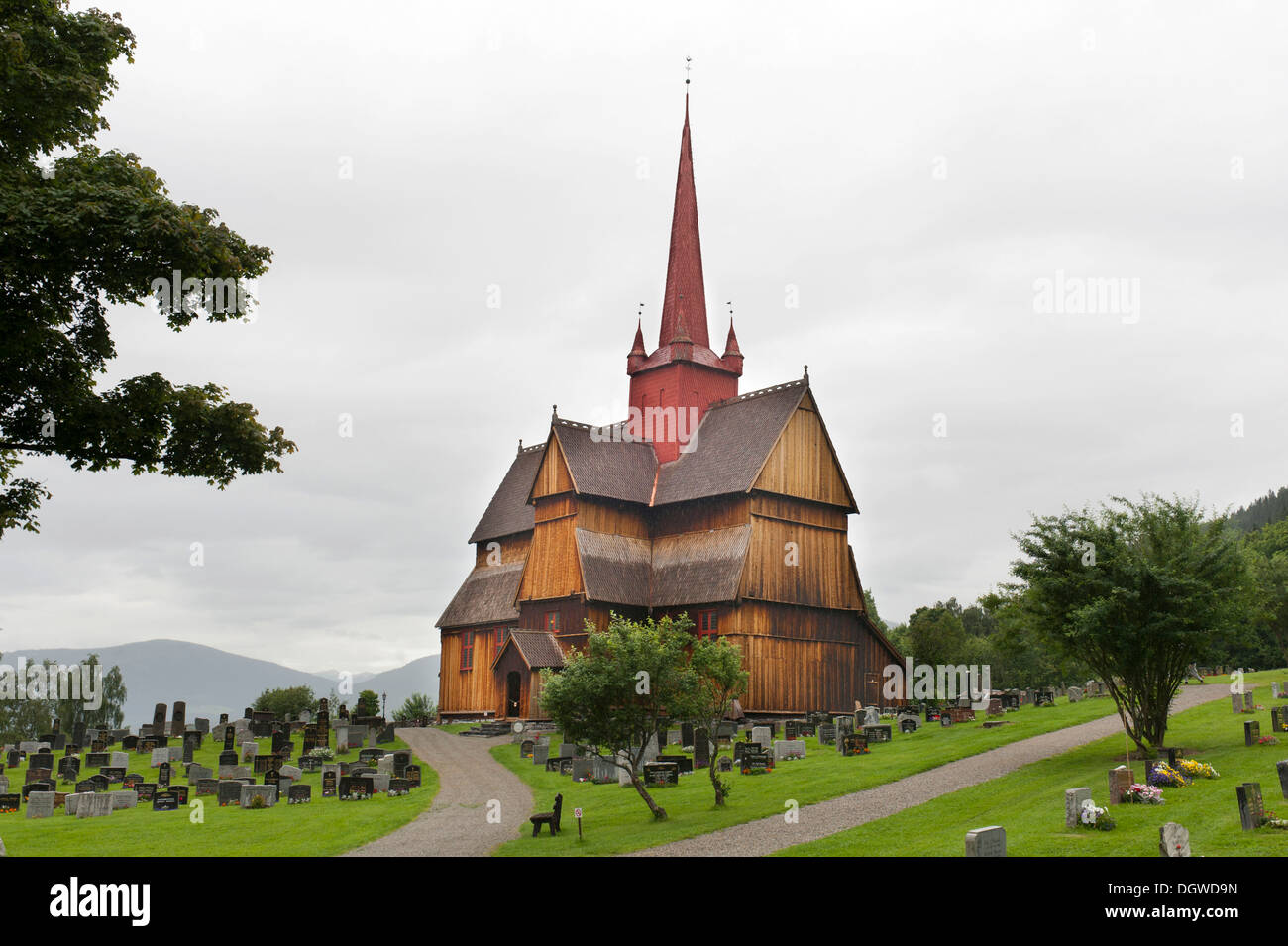 Historical wooden church with a red spire, stave church of Ringebu, Gudbrandsdal, Oppland, Norway, Scandinavia, Northern Europe - Stock Image