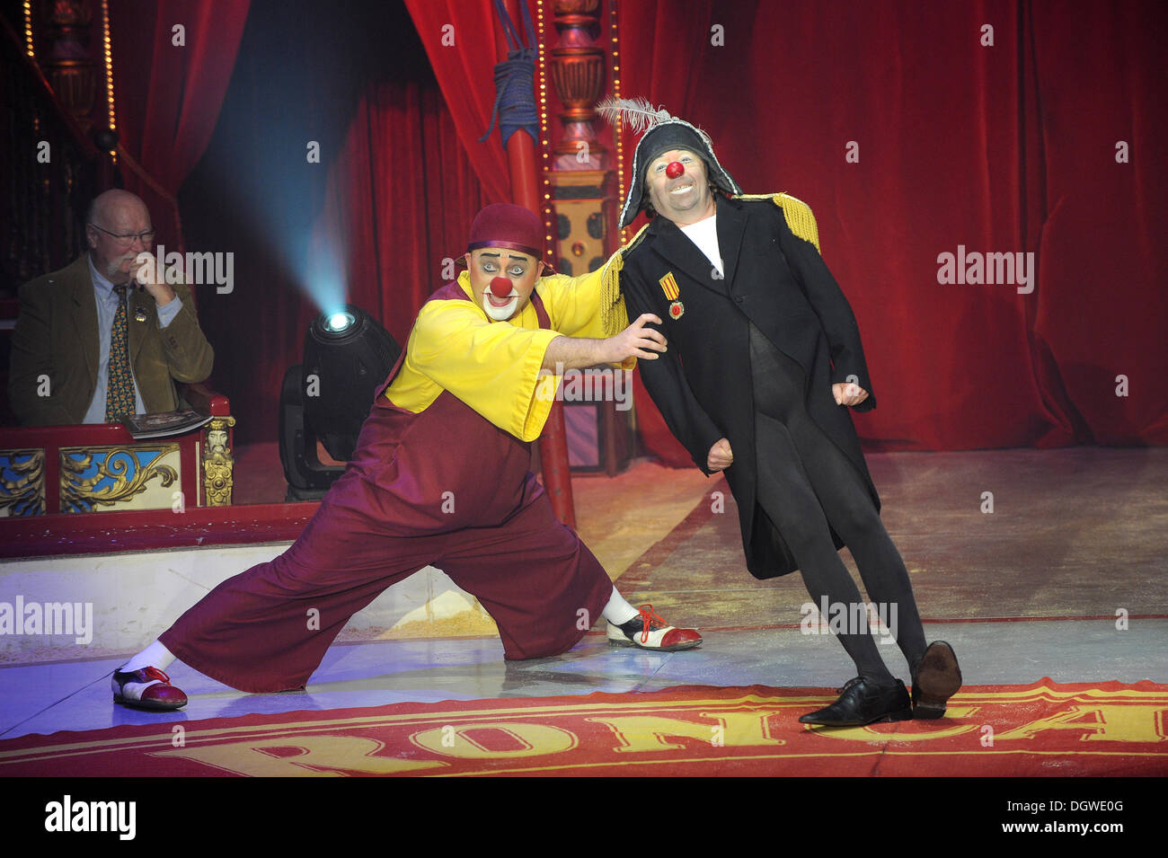 Munich, Germany. 25th Oct, 2013. The KGB clowns perform during the gala premiere of Circus Roncalli in Munich, Germany, 25 October 2013. The circus will performs its program 'Time is Honey' in Munich until 08 December 2013. Photo: URSULA DUEREN/dpa/Alamy Live News - Stock Image