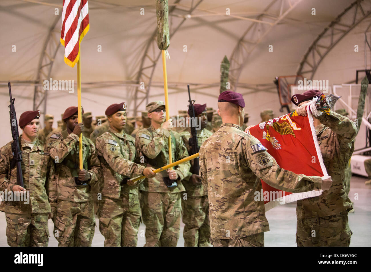 U.S. Army Lt. Col. Brett Sylvia, left, and Sgt. Maj. Steven Tetreault, commanding officer and command sergeant major of Task Force SAW, respectively, case the unit's colors during a ceremony at Camp Leatherneck, Helmand province, Afghanistan, Oct. 21, 201 - Stock Image