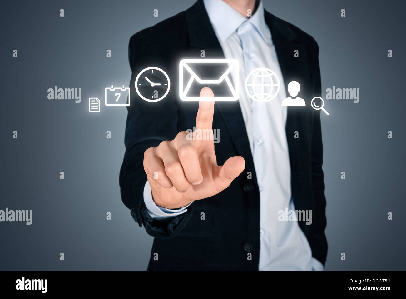 Portrait of young handsome businessman touching futuristic menu interface with various digital icons. Isolated on - Stock Image