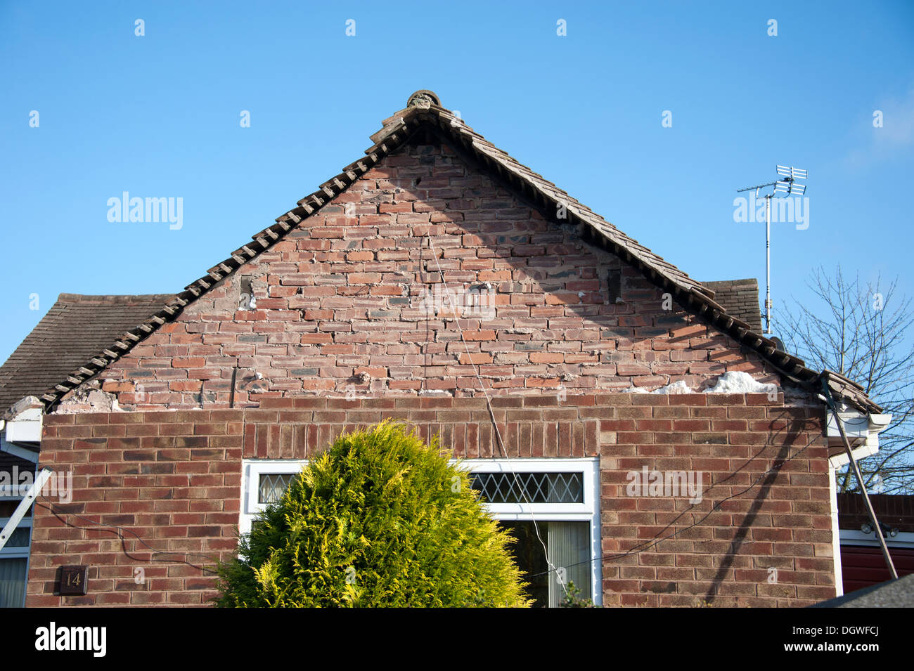 House Gable End Brickwork collapsed ties failed - Stock Image