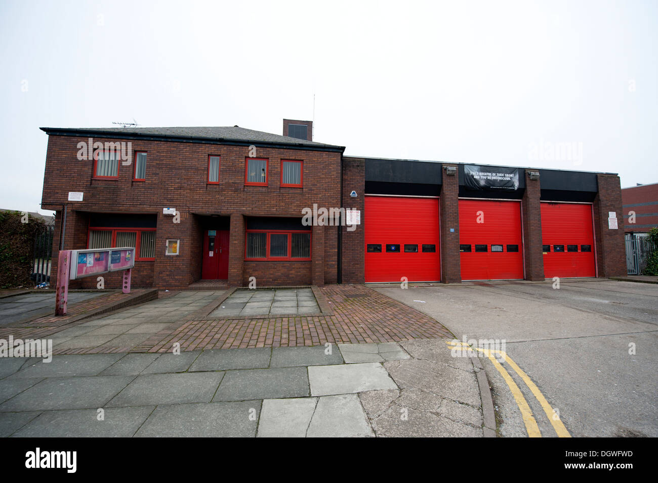 Fire Station House UK 3 Three Red Doors - Stock Image