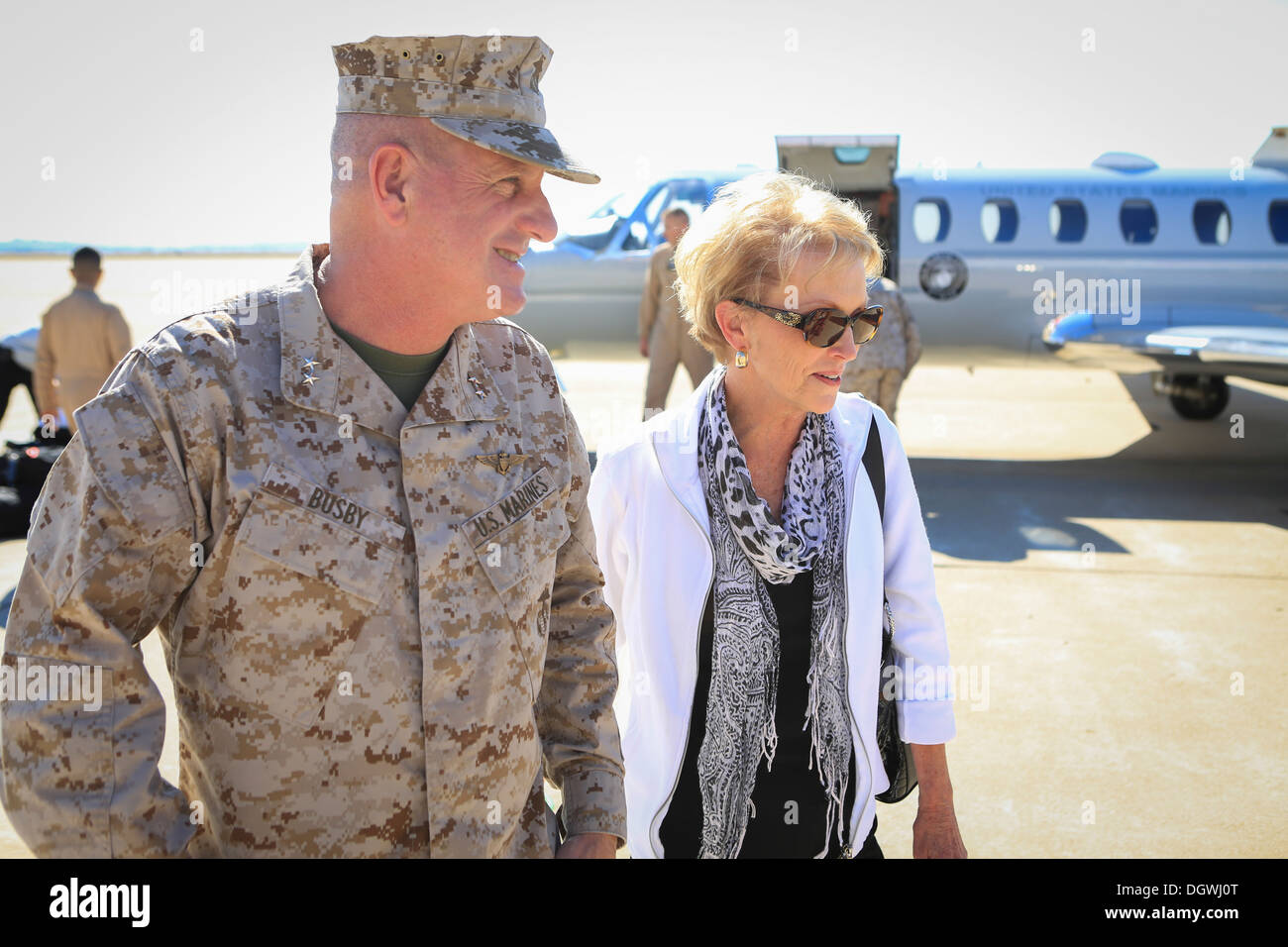 U.S. Marine Corps Maj. Gen. Steven W. Busby, commanding general of the 3rd Marine Aircraft Wing, greets Mrs. Bonnie Stock Photo