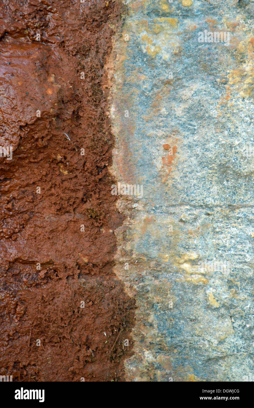 Rock surfaces with patterns created by seepage of water - Stock Image