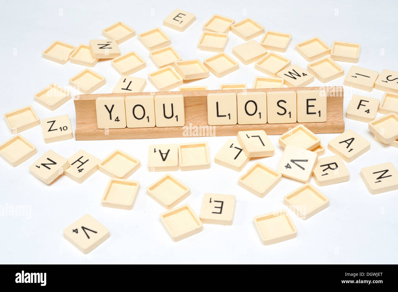 'You Lose' written in scrabble tiles - Stock Image