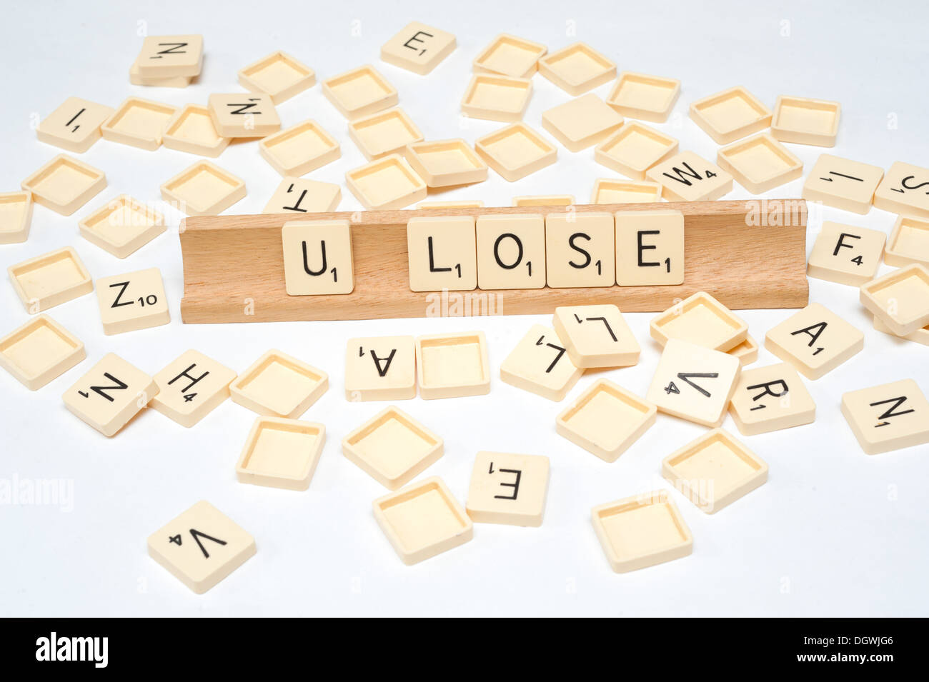 'U Lose' written in scrabble tiles - Stock Image