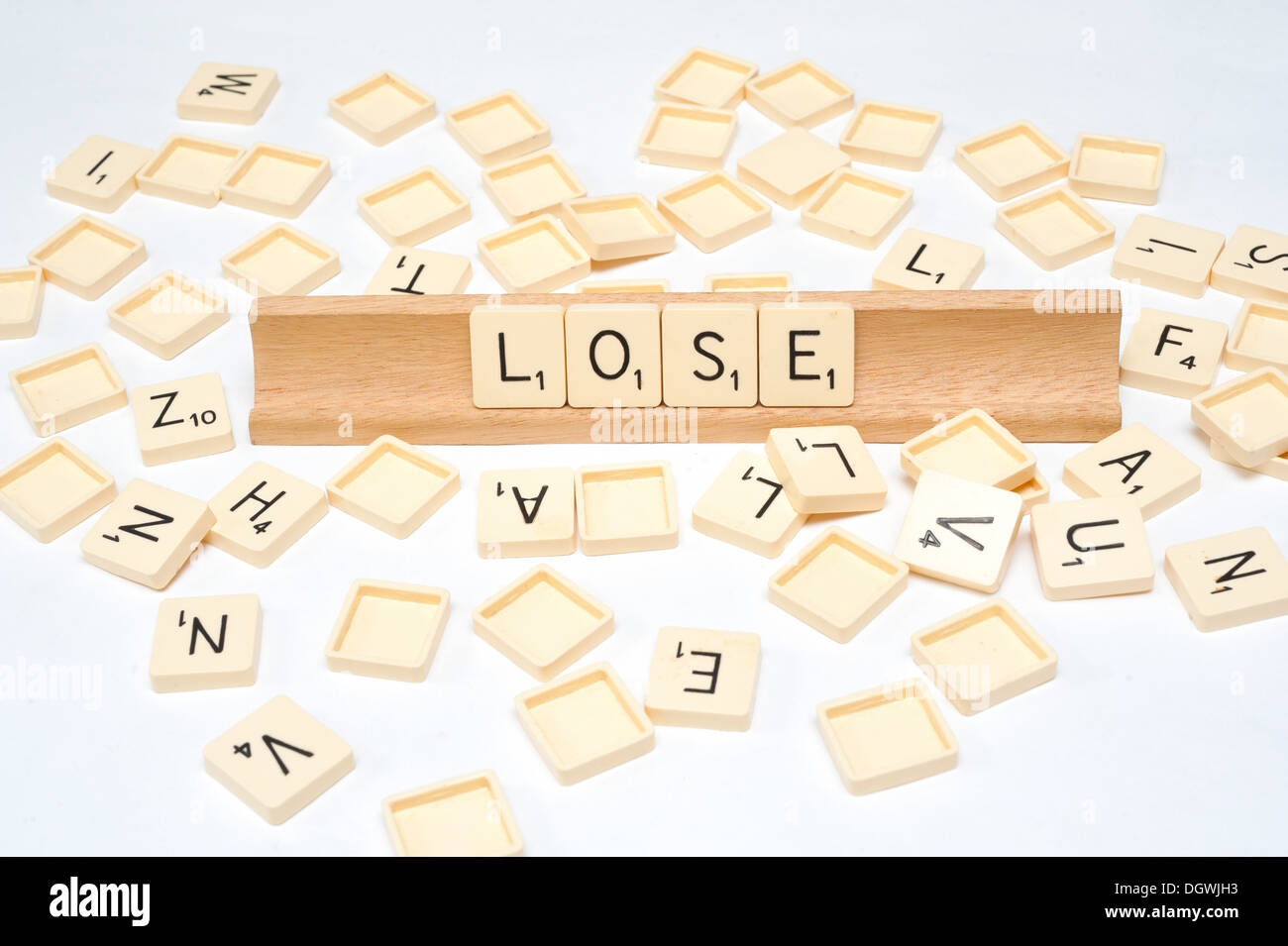 'Lose' written in scrabble tiles - Stock Image
