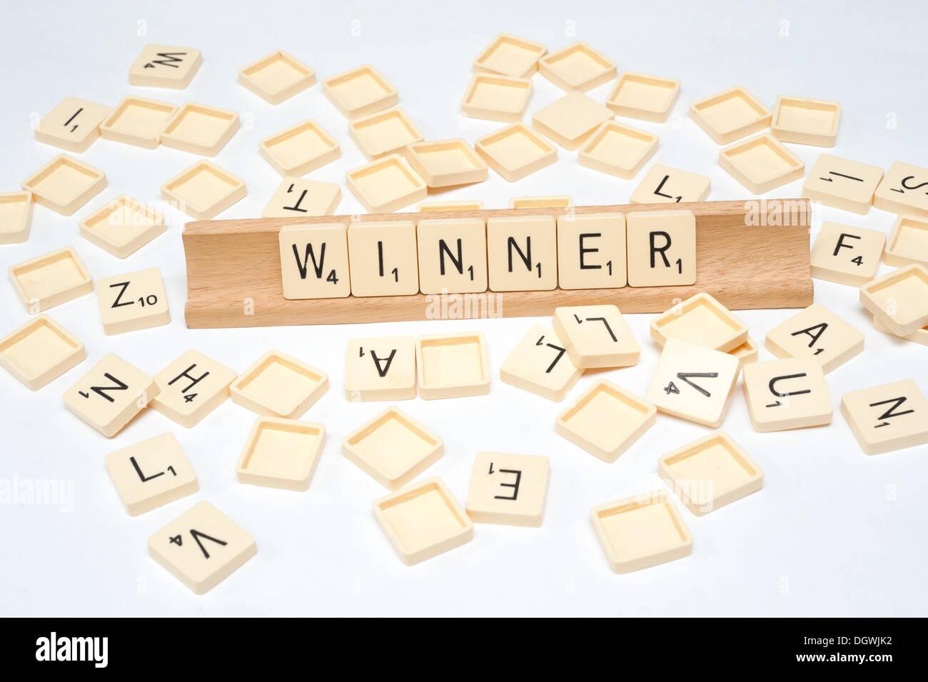 'Winner' written in scrabble tiles - Stock Image
