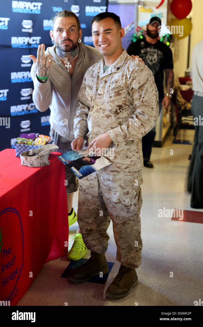 Cpl. Jeffrey Vongsa, an Headquarters and Headquarters Squadron range coach and St. Louis native, receives an autographed photo from Impact wrestling star, Jeff Hardy, at The Great Escape aboard Marine Corps Air Station Miramar, Calif., Oct. 18. Vongsa rec - Stock Image